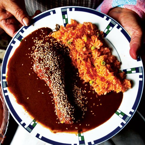 Arroz a la Mexicana (Mexican-Style Red Rice)-- This classic Mexican rice, embellished with tomatoes, serrano chiles, and peas, is a versatile side dish for all kinds of meat and vegetable main dishes.