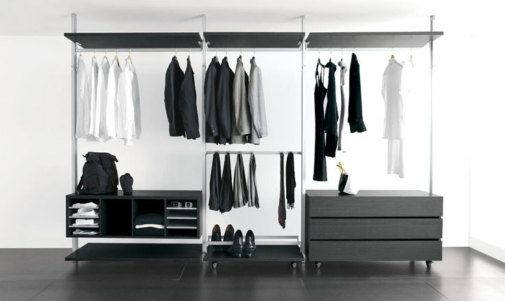 walk-in wardrobe in dark oak melamine, products with blue price. compositions to configure based on your requirements purchasable directly from the factory.