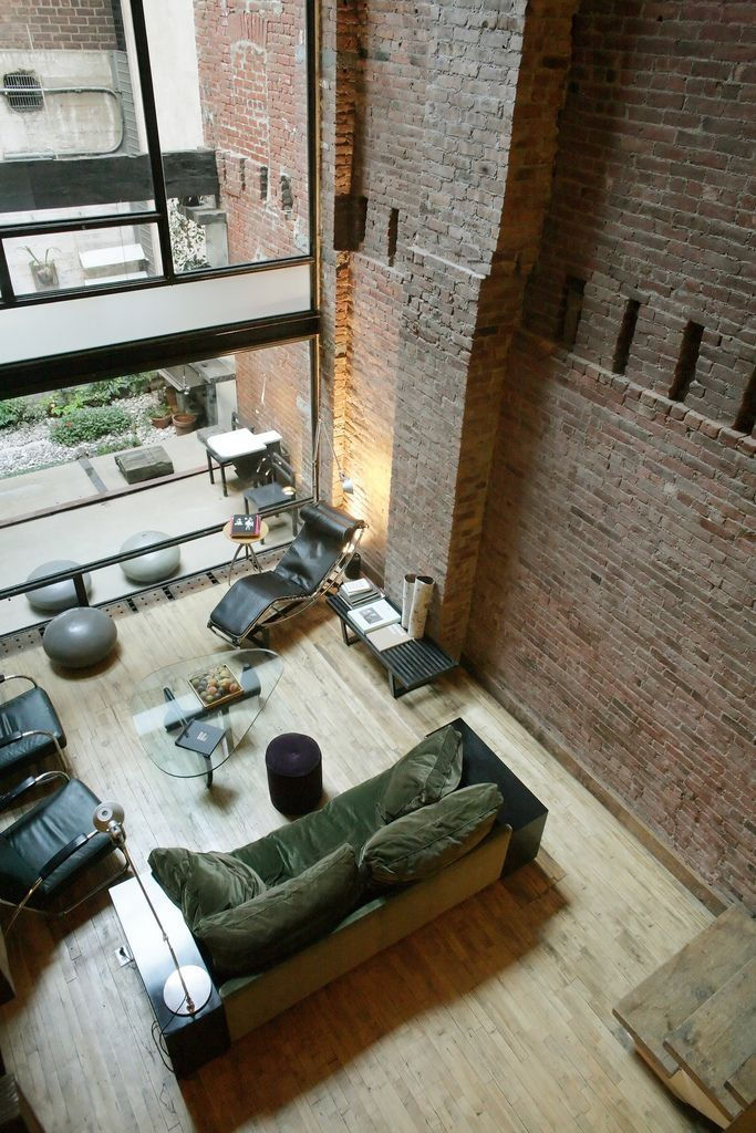 [AB: Love the old brick brushing against the steel, glass, and clean wood floors. And, of course, the open space.]