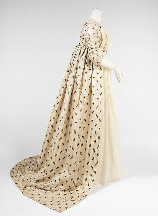 Silk and linen evening overdress, British, 1797-99. This lovely overdress indicates the fine craftsmanship and textiles used at the end of the 18th century to coordinate with the exaggerated fashions of the high waist, large headdresses and skimpy silhouettes.