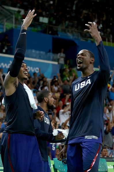 Carmelo Anthony and Kevin Durant of United States celebrate after defeating…