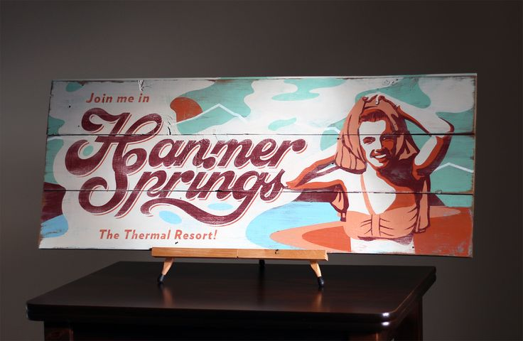 Vintage aesthetic rustic signboard for a popular resort town in New Zealand. A thermal retreat in the South Island town Hanmer Springs. Designed and hand painted by Newstalgia.