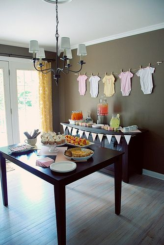 Hang onesies on clothesline as decor