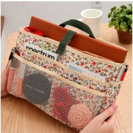 This is one of the best purse organizers I've seen - room to store LOTS of stuff and keep in organized in the bottomless pit that is often my purse:)