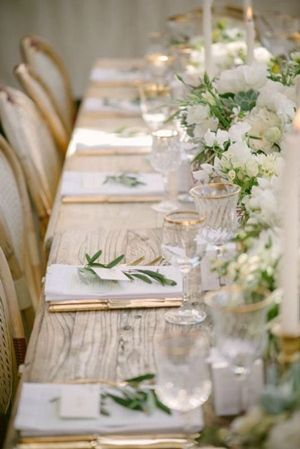 White and Green Wedding Decor | Natural Wood Table | Gold Flatware | White and Green Floral Centerpieces