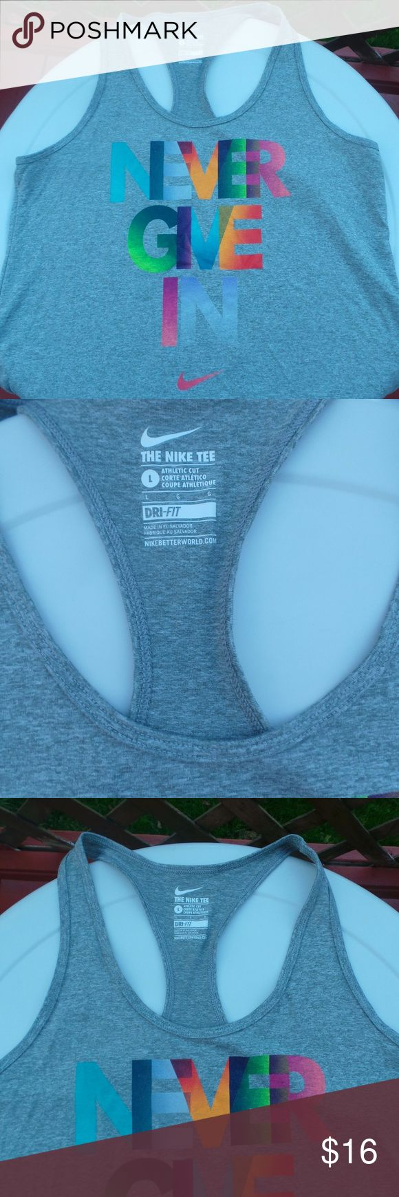 Nike Racer Back Dri Fit Athletic Wear Top size L New without tags. Nike, racerback athletic wear tank top. Gray with multi color working. Cotton. Size Large. Really cute work out wear. Nike Tops