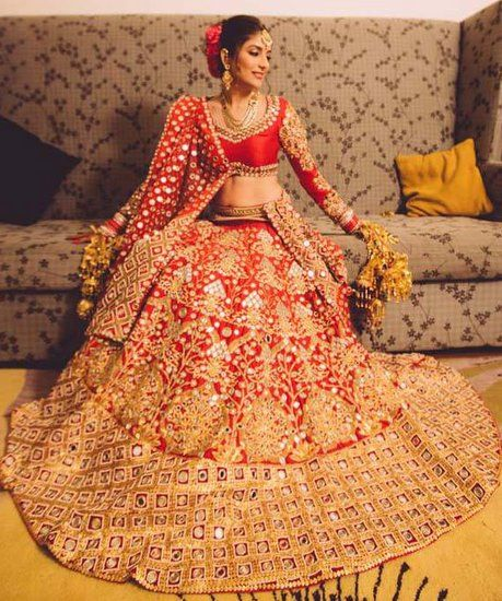 Stunning red and and gold bridal lehenga with blouse and duppatta. Indian bridal fashion.