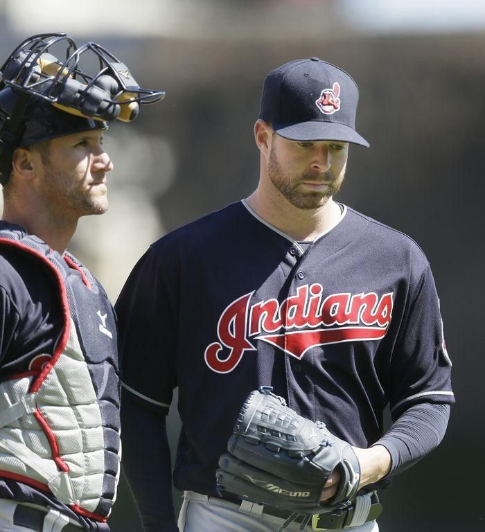 Cleveland Indians starting pitcher Corey Kluber is congratulated by catcher Yan Gomes after the seventh inning of a baseball game against the Detroit Tigers Saturday.