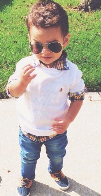 The cutest little boy I've seen!! & his outfit isn't ridiculous lookin