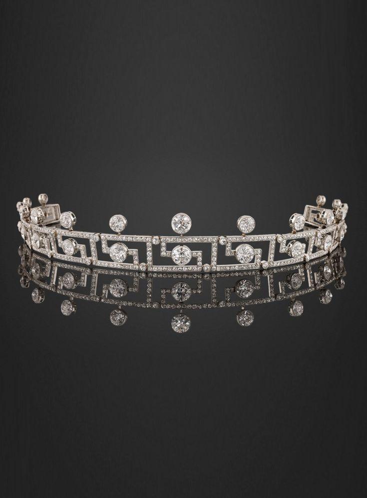 An Art Deco platinum and diamond tiara, circa 1925. Designed as a series of openwork Greek key segments, each set with brilliant-cut diamonds.