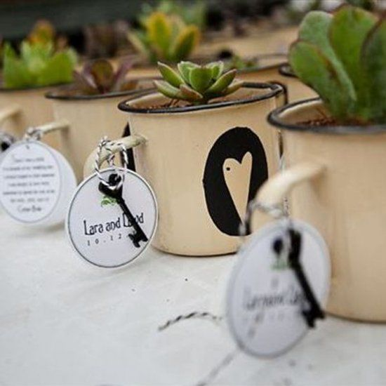 Using tin enamelware mugs for favors or decorations adds a sweet rustic touch to your wedding style. (Credit: DuWayne)