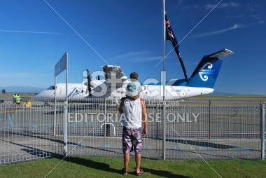 Man and Boy with an Air New Zealand Aeroplane Royalty Free Stock Photo