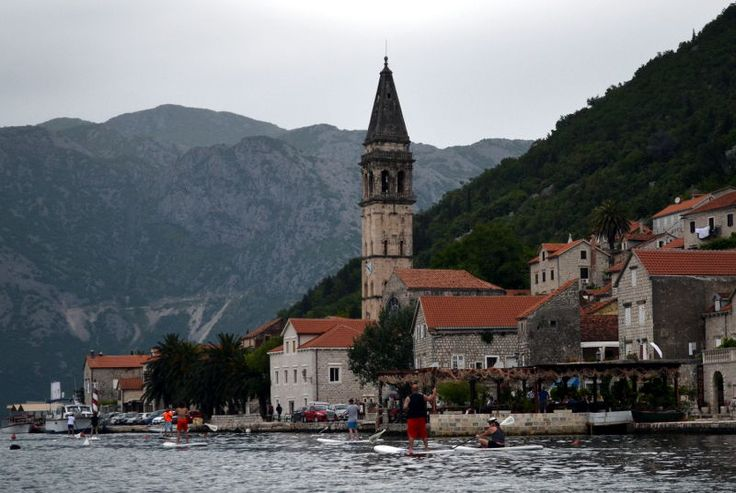 SUP boarding along coast of Old a Town Perast, Montenegro