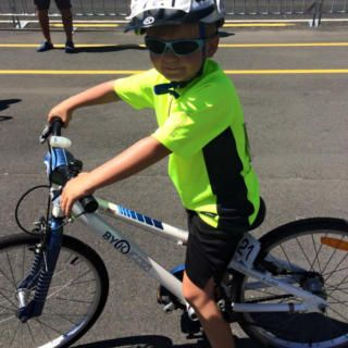 6 year old boy on his E-450 kids bike riding the Rev Cycle Challenge in New Zealand
