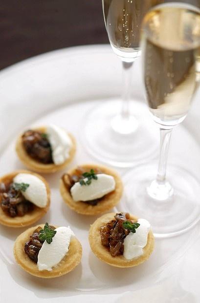 Party favourites ... Brigitte Hafner's caramelised onion tartlets. Photo by Marina Oliphant. Recipe: http://www.smh.com.au/lifestyle/cuisine/vegetarian/recipe/caramelised-onion-tartlets-20111019-1m4ap.html?rand=1352071576361