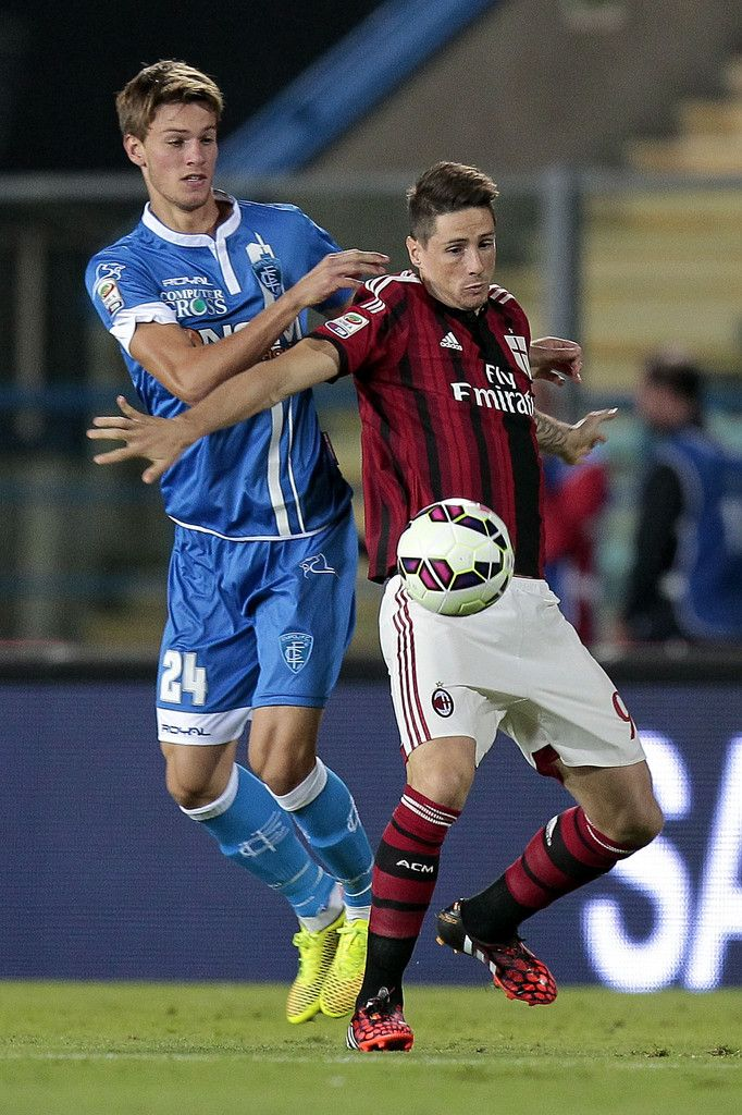 Daniele Rugani of Empoli FC battles for the ball with Fernando Torres of AC Milan during the Serie A match between Empoli FC and AC Milan at Stadio Carlo Castellani on September 23, 2014 in Empoli, Italy.