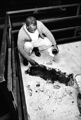 Theatrice Bailey attempts to clean blood from the balcony, hours after the shooting of Dr. Martin Luther King Jr. April 4th, 1968-