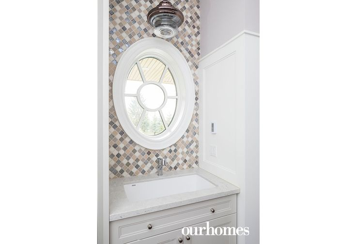 "An oval window with a view adds charm to the laundry room. See more of this home in ""Jack-of-all-Trades Hamilton Builder Celebrates 65 Years"" from OUR HOMES Hamilton Spring 2017: http://www.ourhomes.ca/articles/build/article/jackofalltrades-hamilton-builder-celebrates-65-years?full=true"