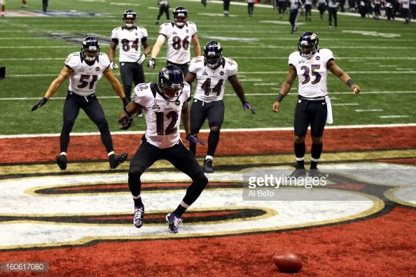 Jacoby Jones #12 of the Baltimore Ravens celebrates his record 108-yard kickoff return for a touchdown with his teammates in the third quarter against the San Francisco 49ers during Super Bowl XLVII at the Mercedes-Benz Superdome on February 3, 2013 in New Orleans, Louisiana.