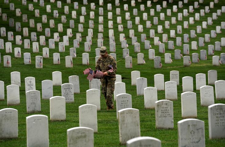 A soldier from the 3rd U.S. Infantry Regiment (Old Guard) takes part in 'Flags-in', where a flag is placed at each of the 284,000 headstones at Arlington National Cemetery, ahead of Memorial Day, in Arlington, Virginia, U.S., May 25, 2017. REUTERS/Kevin Lamarque via @AOL_Lifestyle Read more: https://www.aol.com/article/news/2017/05/25/us-soldiers-plant-thousands-of-flags-at-cemetery-in-memorial-day/22110184/?a_dgi=aolshare_pinterest#fullscreen
