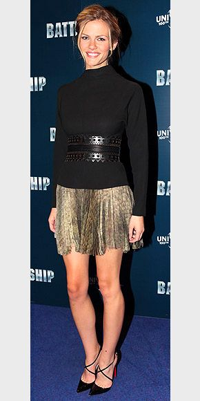 Ready to break out a warm-weather mini, but the temperature isn't cooperating? Make it work with a darker hue like Brooklyn's, which pairs well with a high-neck soft sweater and an edgy belt. From @People magazine