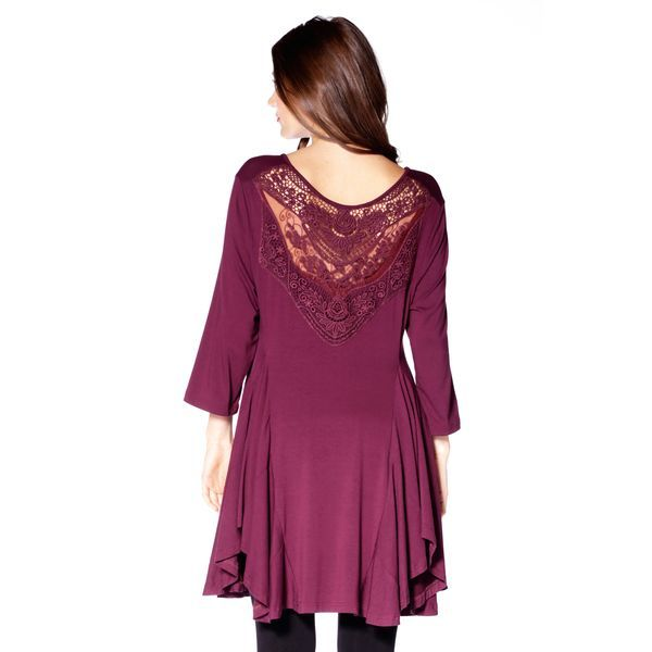 Add a little interest! This comfy tunic top features a lace back detailing to add a touch of sexy. Pair with leggings or jeans to complete the look.  Content: 95% Rayon, 5% Spandex  Fit: Relaxed