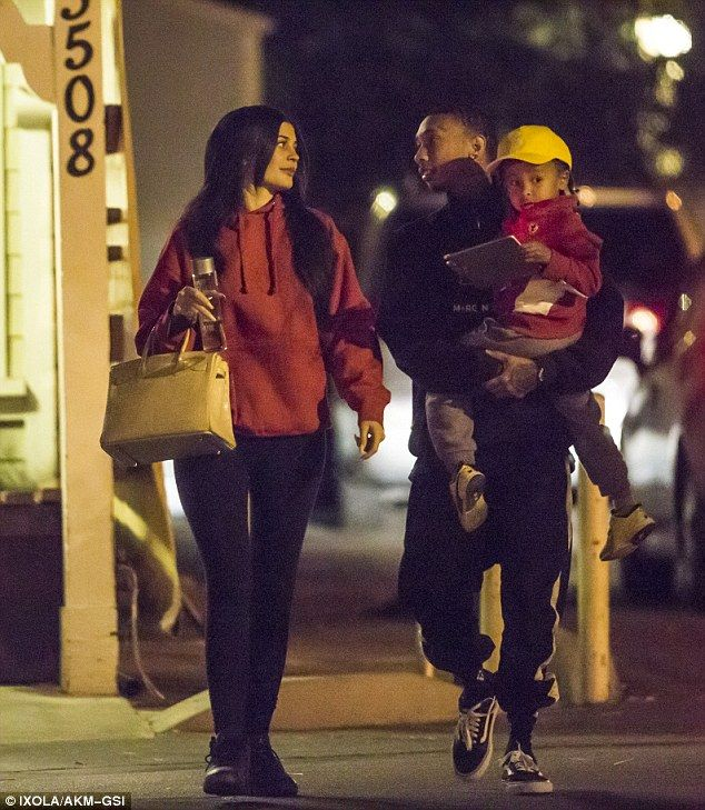 Chill: The blended family looked casual for their pre-Thanksgiving meal, with 19-year-old Kylie rocking tight black leggings and a large red hoodie