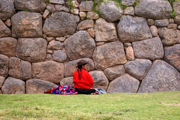 love the scale of the stones behind her. some small some huge...Wings Workspaces