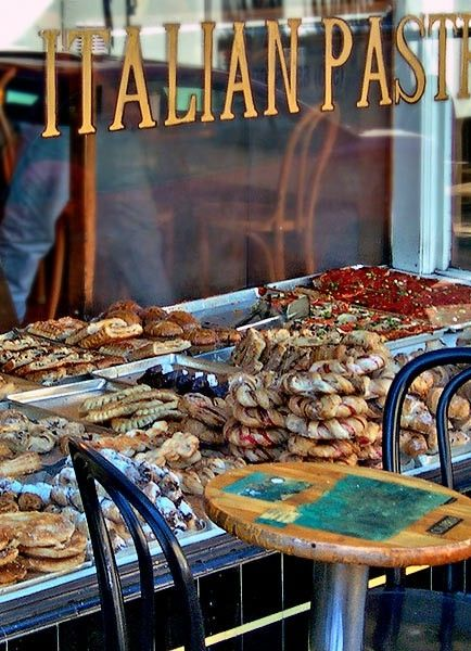 Italian pastries and pizza in a San Francisco North Beach bakery window.