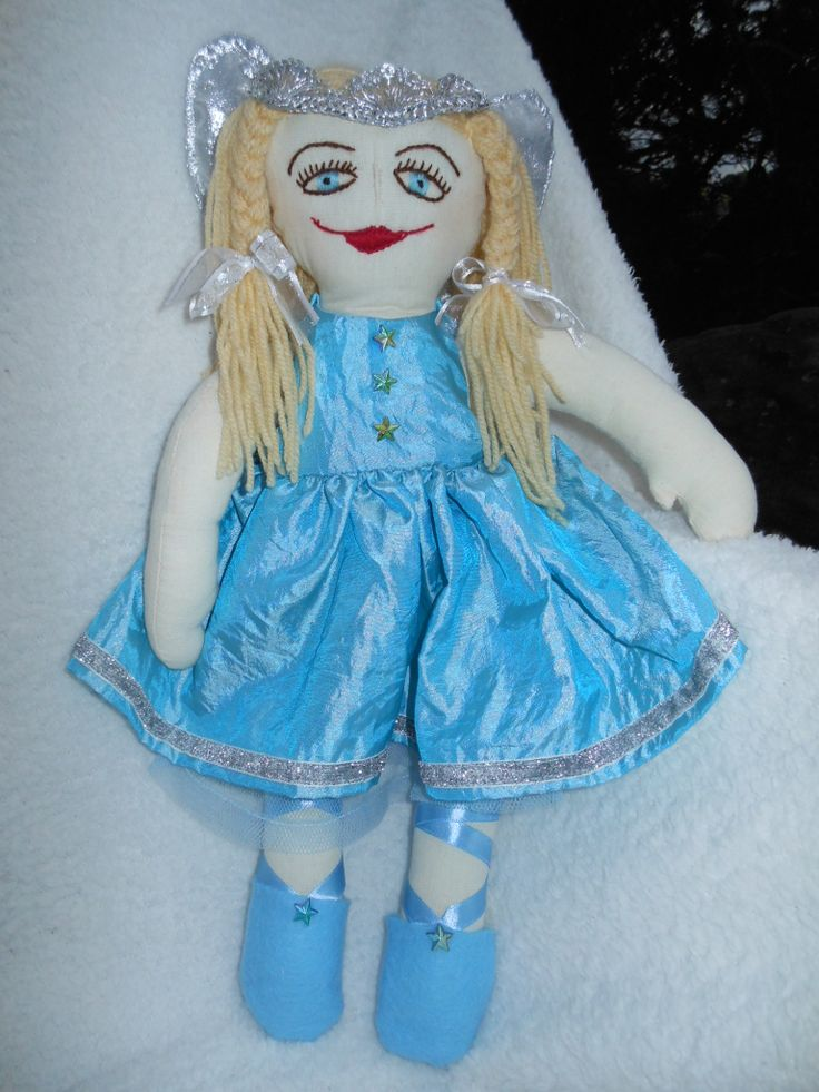 A beautiful fairy doll, Princess Rosy Posy elegantly dressed in a taffeta dress with petticoat and panties.  She has wings which can be removed as can her dress.  So any little girl can have fun dressing and undressing this doll.