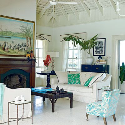 High ceilings and lots of white and splashes of color give this room a very tropical feel.