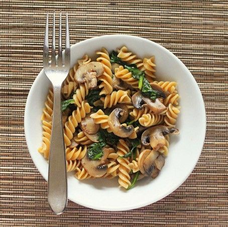 Whole Grain Fusilli with browned Mushrooms and Spinach. vegan