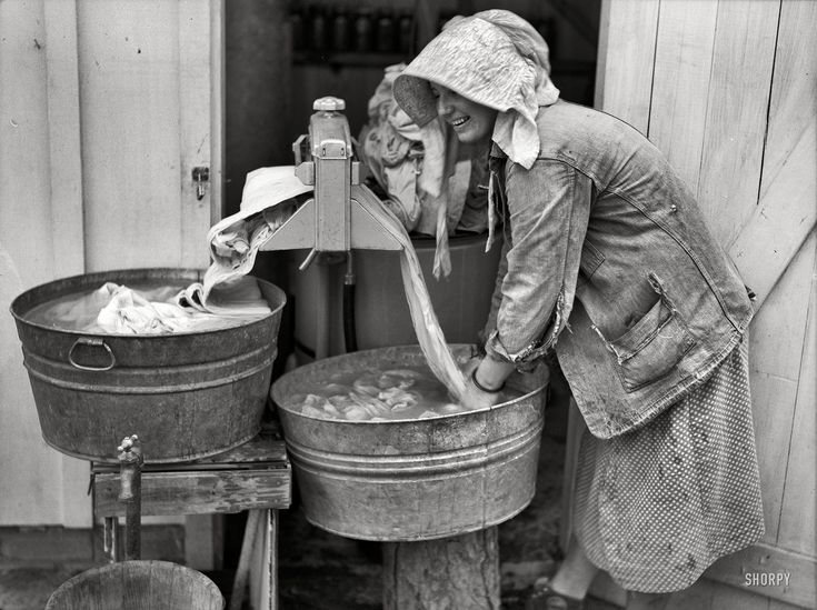 "May 1938. Irwinville Farms, Georgia. ""Mrs. Coleman doing a washing."" Slow but steady progress in the science of mechanized laundry. Medium-format nitrate negative by John Vachon for the Resettlement Administration."