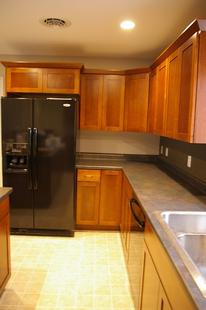 Black appliances black countertops dark countertops for Carriage house kitchen cabinets