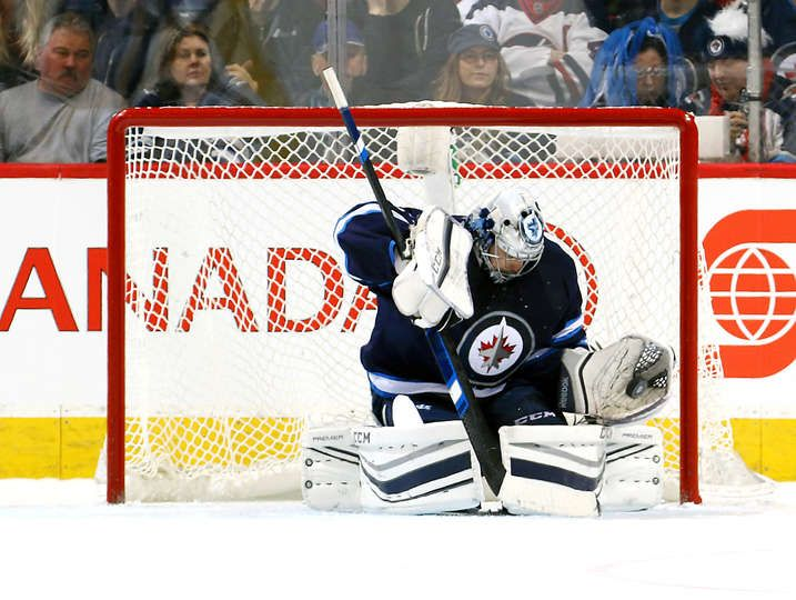 WINNIPEG, MB - JANUARY 21: Goaltender Ondrej Pavelec #31 of the Winnipeg Jets makes a glove save during second period action against the St. Louis Blues at the MTS Centre on January 21, 2017 in Winnipeg, Manitoba, Canada. (Photo by Jonathan Kozub/NHLI via Getty Images)