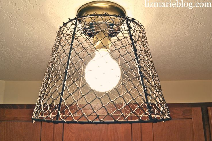 Wire basket light fixture. Step by step instructions. So easy & cheap & adds an industrial charm to any space. #industrial #DIY #laundryroom