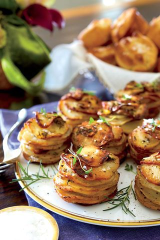 Prepare to impress you holiday crowd with a dish they've never seen—or tasted before—but will instantly fall in love with. These Herbed Potato Stacks are made with a short list of ingredients, but they completely transform the humble potato into an elegant side dish. A mandoline is key for getting extra thin, consistent slices. Most mandolines are very safe and come with a hand guard to make slicing easier and safer. Our Test Kitchen raved about the look and flavor of the dish, saying…