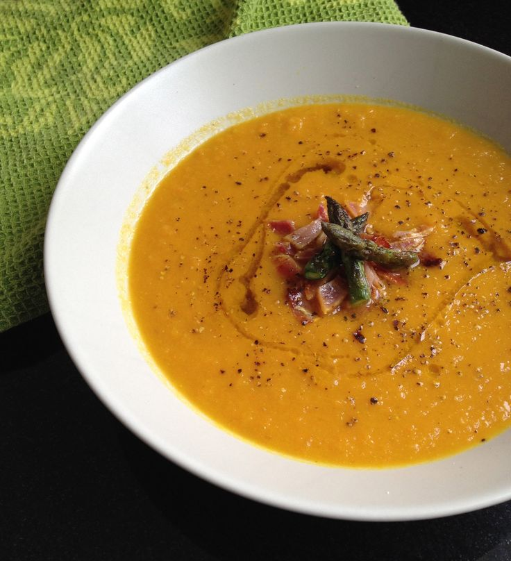 Roasted Pumpkin Carrot Butternut Squash Soup. I omitted the curry seasoning and bacon bits/jamonserrano pieces/asparagus and instead used pumpkin pie spices, a dash of cayenne, a little almond milk (with filtered water). The carrots were difficult to peel after being roasted (it made me seriously frustrated) and it ended up breaking my cheap old blender... but it was delicious.