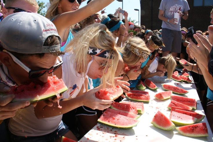 Students participate in a watermelon eating competition for Lambda Chi Alpha fraternities Watermelonfest philanthropy event.