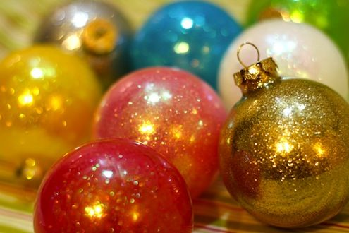 clear plastic ornaments with glitter/put a small amount of future floor wax in the ornament and swirl around-dump out extra, put a small amount of glitter inside and swirl around-dump out extra, allow to dry and replace the little hook and you're done!