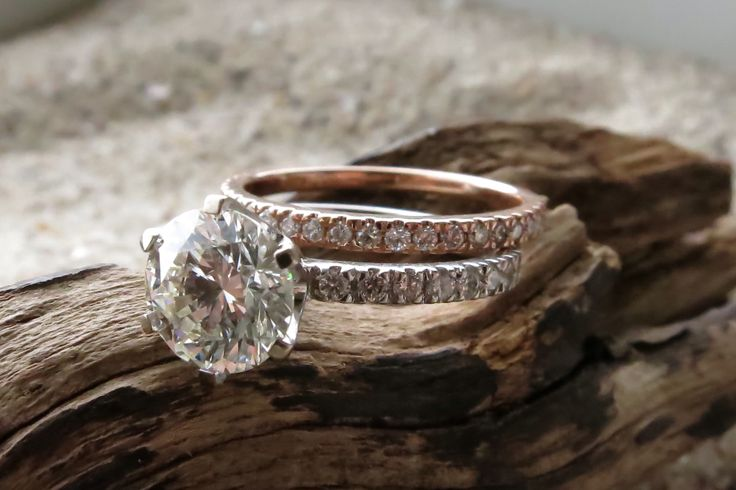 1.60ct centre stone with 20 two pointer diamonds in 18ct white gold. 18ct Rose gold with one pointer diamonds. zmjewellery.co.za