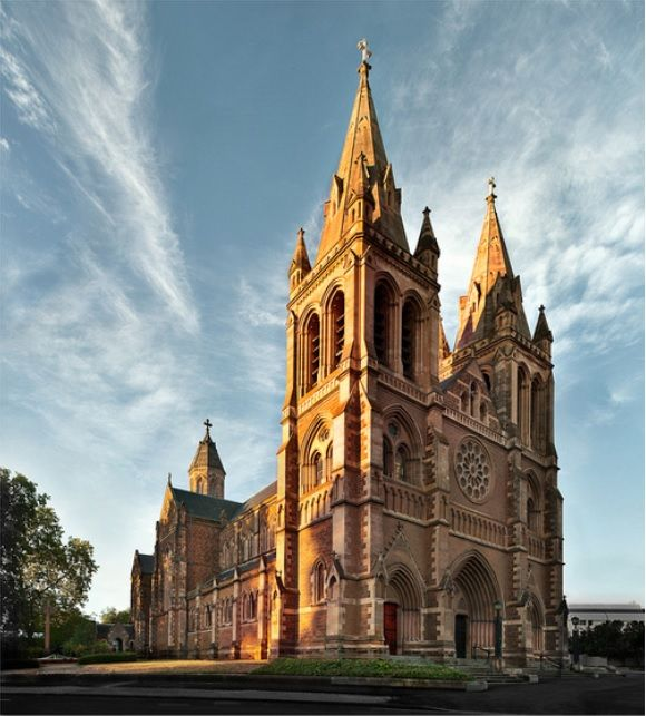 St Peter's Cathedral, North Adelaide, South Australia. The cathedral is situated on approximately one acre (4,000 m²) of land at the corner of Pennington Terrace & King William Road. The south face has similar features to the Cathedral of Notre Dame in Paris, including an ornate rose window above the main entrance which depicts stories of South Australia & the Bible. Photo By © Peter E Barnes