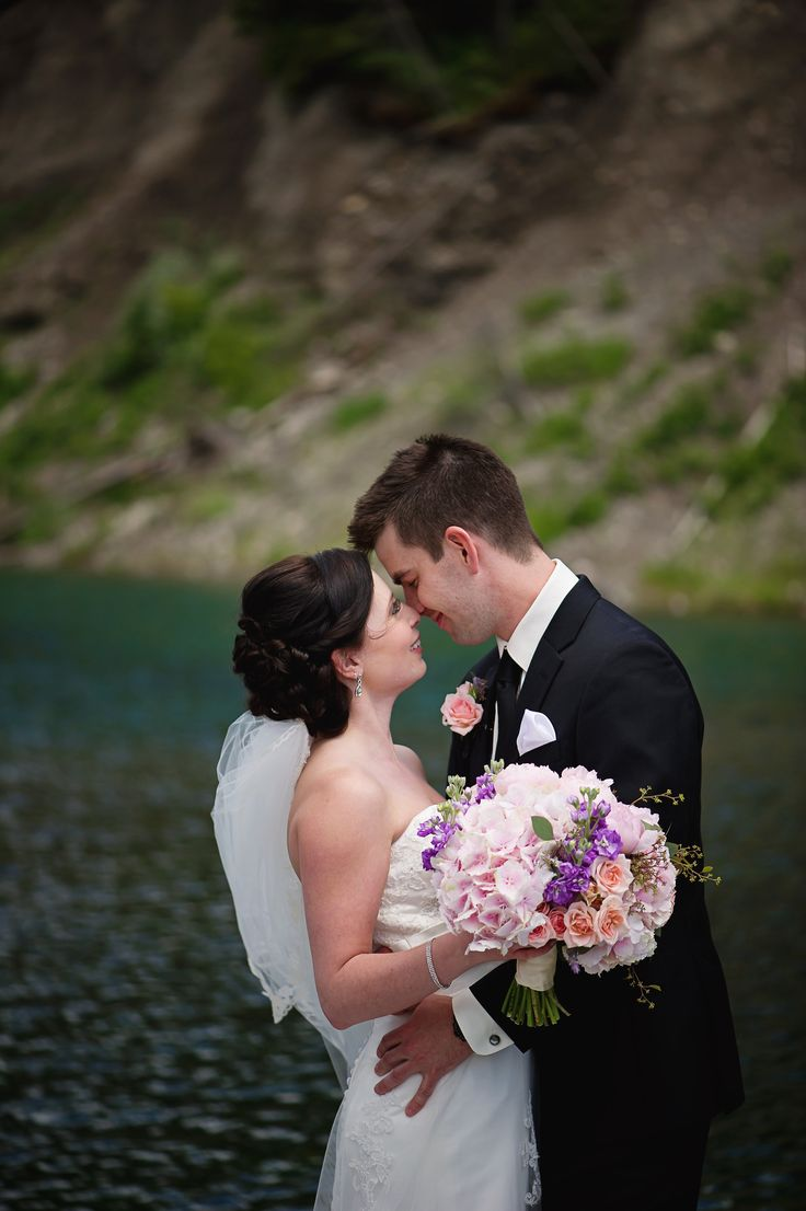 Dutch pink hydrangea, peach spray roses and purple stock bridal bouquet for a wedding at the Delta Lodge Kananaskis.  Photo: @carlinanquist   Flowers by Janie- Calgary Wedding Florist www.flowersbyjanie.com