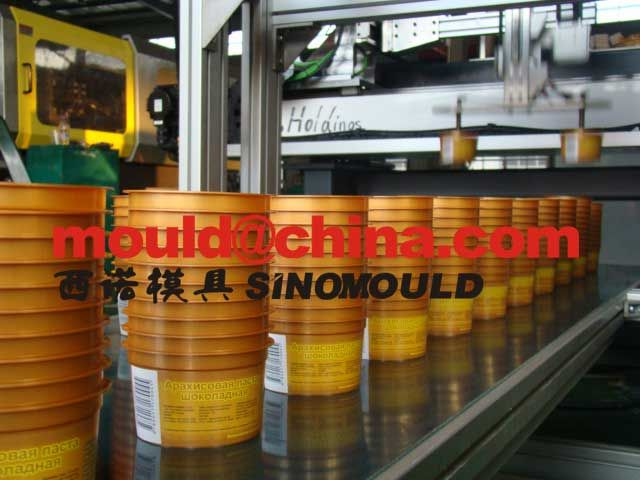 In-mold labeling is a pre-decorating technique used worldwide for blow molded bottles as well as injection molded and thermoformed containers or other plastic objects. Pre-decoration is the application of a label to a container before it is filled with product. http://www.dakumar.com/in-mold-labeling.htm