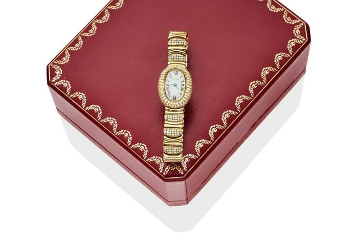 A Lady's gold and diamond Mini-Baignoire wristwatch, Cartier, circa late 1990's. Quartz. Ref: 2368. Case number: GC20508. Oval case with cream dial and painted black Roman numerals, diamond set bezel and bracelet. Case, dial, movement and bracelet signed. 18ct yellow gold. Total weight 69.60 grams. Original box and papers. - Price Estimate: $15000 - $18000