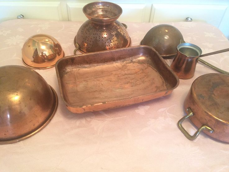 7 Piece Copper And Brass Strainer, Baking Molds, Mixing Bowls, Ladle And Bakin Pan Hangable Copper Kitchen Primitive Industrial Kitchen very Rustic! Good Used vintage condition. Pan is an odd shape~ with a lowered bottom kinda rounded see last pictures~ Many pieces have a rustic look not a shiny set. For a country rustic/Primitive kitchen Strainer Measures 11 1/4 inches wide by 5 1/4 inches deep. Baking pan measures 12 1/2 inches by 8 inches and 2 1/4 inches deep Larg...