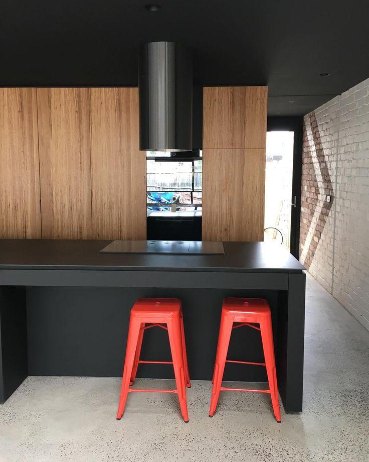 "Timber Kitchen Black Benchtop: ""unvailing Of The #rangehood Tube. #blackbutt #timber"