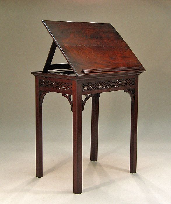 """GEORGE III MAHOGANY ARCHITECT'S TABLE -   England, c1760-65, In the Chinese Chippendale manner, the rectangular hinged double-ratcheting adjustable top, over an elaborately pierced fret carved frieze, raised on square chamfered legs with pierced corner brackets. PROVENANCE: From The Collection of The University of Virginia Art Museum. 29 ¾""""H x 25 ¼""""W x 19""""D"""