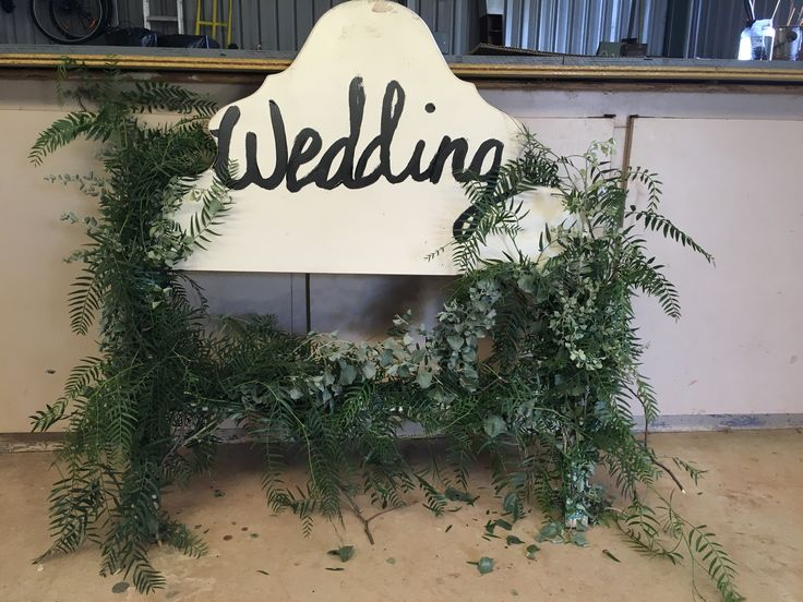 Wedding sign made from an old bed head.