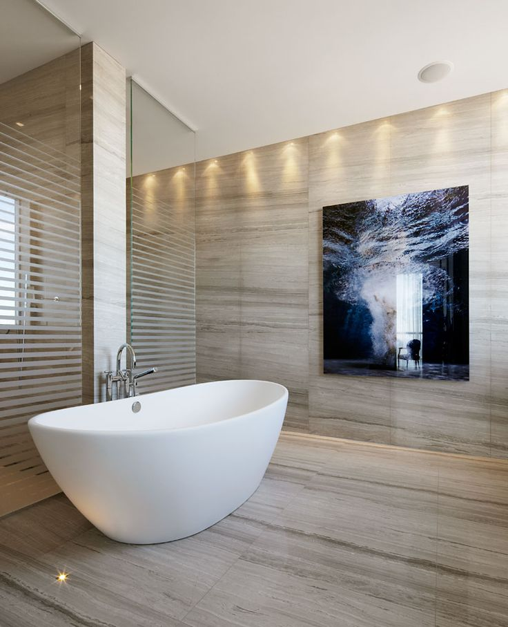 Clean and modern bathroom in a residence on the Esplanade designed by Munge Leung